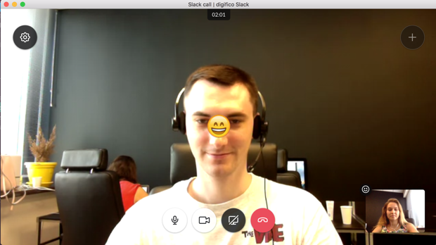 Using emojis during the video call at Slack