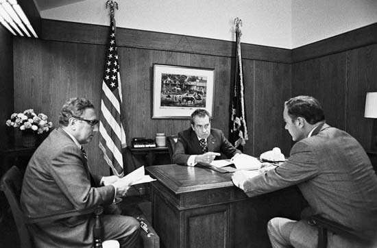 Henry A. Kissinger with subordinates